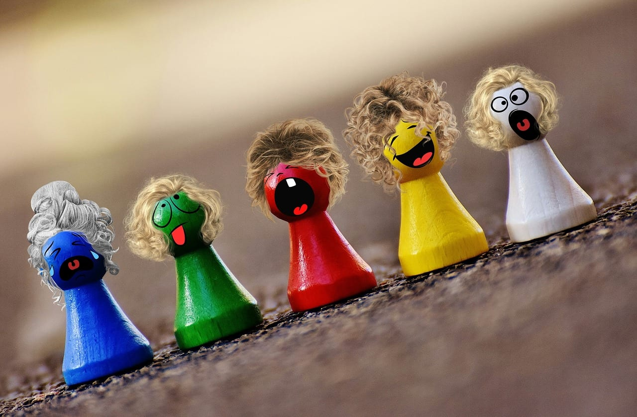 Wooden coloured pegs with faces